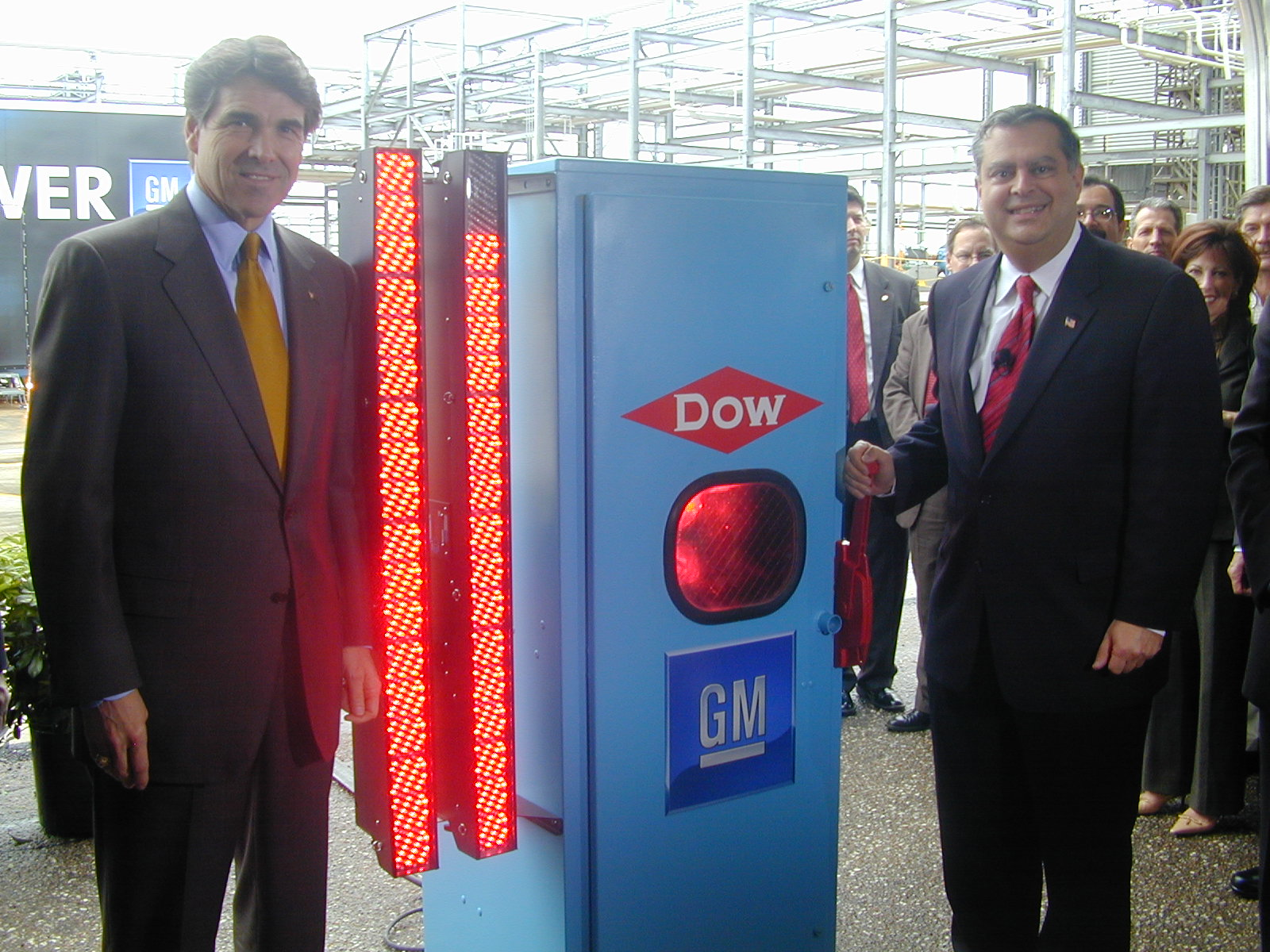 Dept. of Enegery Secretaries Rick Perry & Spencer Abraham pose for me on a GM Junket  Marketing Hydrogen with DOW Chemical stand in front of a hydrogen fuel pump